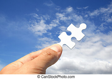 Jigsaw Key - Jigsaw piece as key in sky