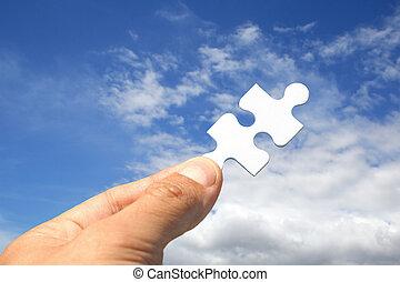 Jigsaw Key - Jigsaw piece as key in sky