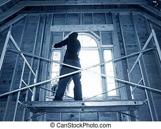 Window Installation - men installing arched window on...