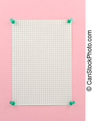 piece of squared paper pinned to pink wall