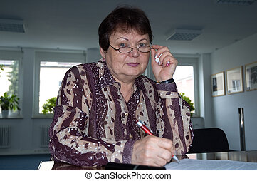 business woman - elderly woman in business outfit with pen...
