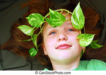 Summer girl - Portrait of girl with green leaves