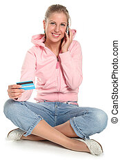 Woman sitting - Woman with credit card and mobile phone