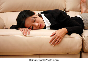 tired woman - woman taking a nap on the couch
