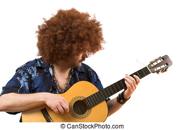 Old hippie playing on his guitar - Old hippie with wild afro...