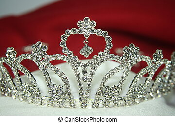 silver tiara on white glove