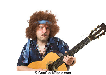 Crazy guitar player - Old hippie putting on a face while...
