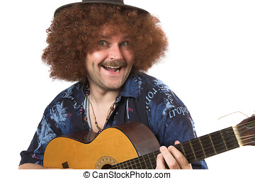 Crazy musician - Musician with hat and guitar pulling a face
