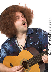 Singing the blues - Hippie singing along with his guitar