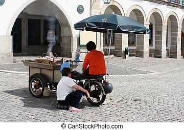 selling chestnuts - chestnut vendors in Evora, Portugal