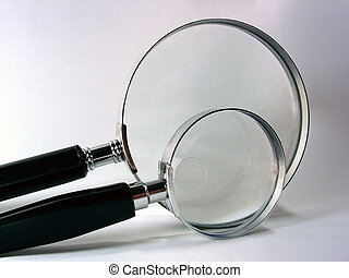 Magnifying Glasses - two magnifying glasses - one small and...