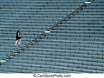 man running bleachers - man running up stadium bleachers