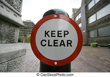 keep clear - a keep clear sign on a pillar in the barbican,...