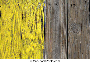 Yellow painted wooden planks on the city pier Anna maria...