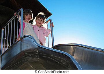twins on a bent slide - twins standing at the top on a bent...