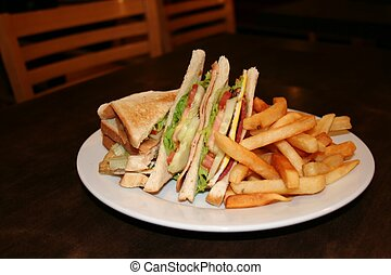 Club sandwich, with french fries