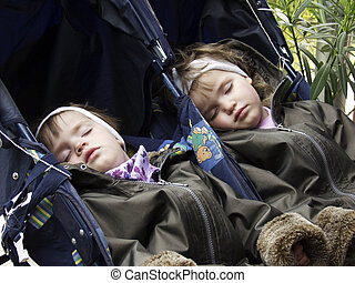 sleeping twins - twins sleeping in a carriage