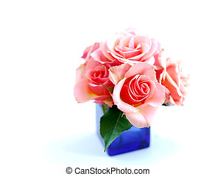 Rose bouquet in a blue vase on white background