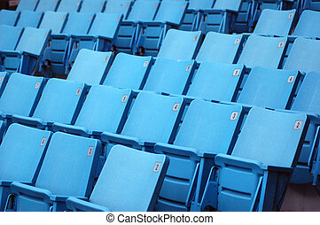 Seats - Rows of blue seats with numbers on their backrests