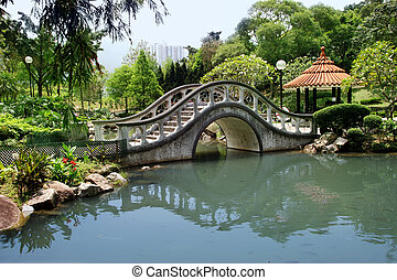 Park in Hong Kong - Park with a bridge in Hong Kong...