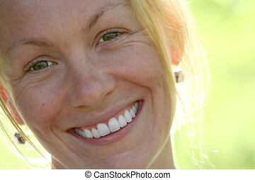 Girl Green - A portrait of a young womans smiling face