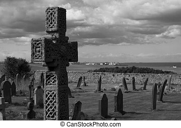 Cross Gravestone - Celtic cross overlooking an old graveyard...