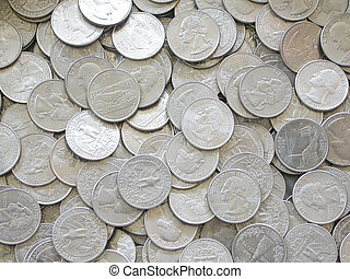 Quarters - a pile of United States Quarters