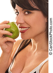 Forbidden Fruit - A beautiful smiling woman eating a fresh...