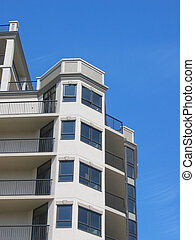 Condo building with blue sky