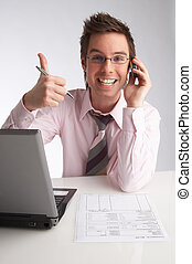 OK - businessman talks on the phone and shows the OK sign