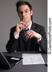 consultancy - businessman with notebook and a sheet of paper
