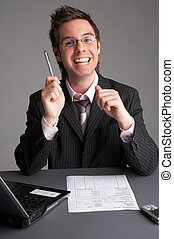 success - businessman with notebook and a sheet of paper