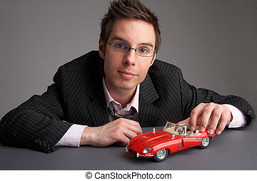 red car - businessman with a red miniature car