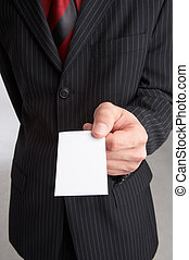 business-card - businessman holds a business-card