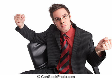 power - businessman sits in chair showing two fists