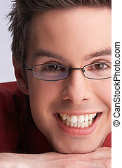 smiling man with white teeth with glasses