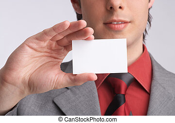 business-card - businessman presents a business-card