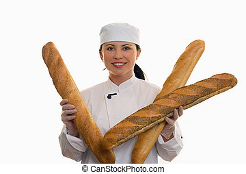 Baker with long rolls - Baker holding a variety of long...