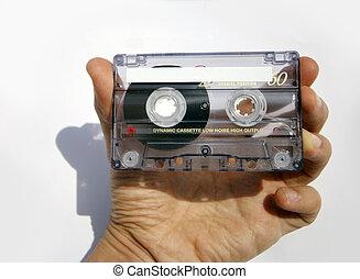 cassette tape - hand holding cassette tape