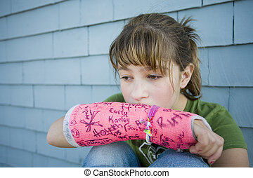 Broken Arm - Photo of Maggie in a pink cast.