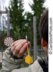 Darts - Teen playng darts