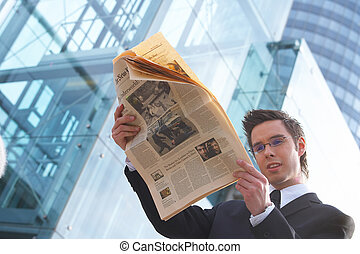 news - businessman reads the newspaper