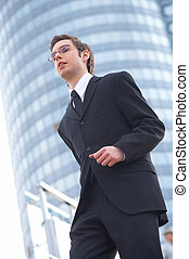 modern - walking businessman with modern building in the...