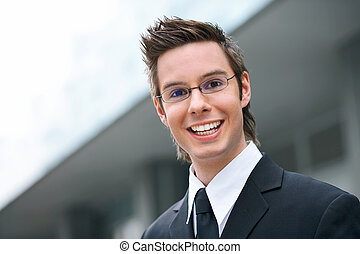 young businessman - smiling young businessman