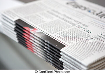 news - some fresh newspapers waiting to be taken away