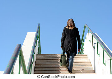 Lonely woman - Woman climbing stairs