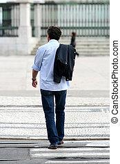 Cool man walking in the street