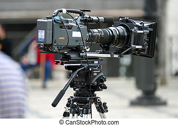 Professional Camera - Movie camera in the street