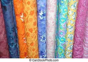 Colorful fabric bolt - Fabric bolts of quilting material.