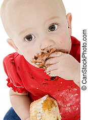 Baby with Muffins - Baby eating cake, making mess on face.